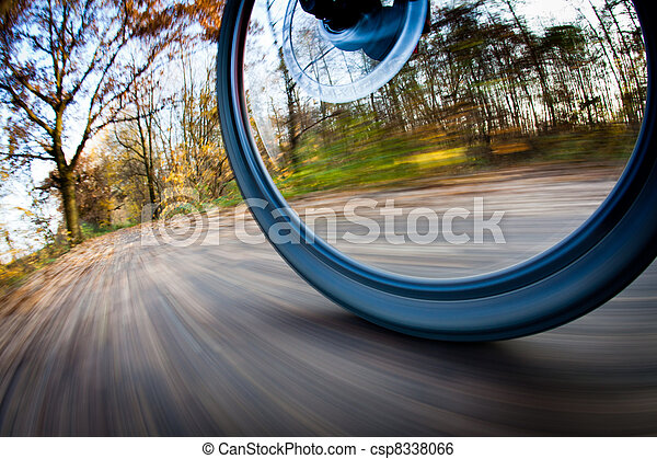 Bicycle riding in a city park on a lovely autumn/fall day  - csp8338066