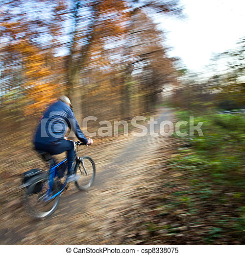 Bicycle riding in a city park on a lovely autumn/fall day - csp8338075