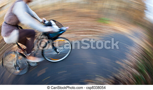 Bicycle riding in a city park on a lovely autumn/fall day - csp8338054