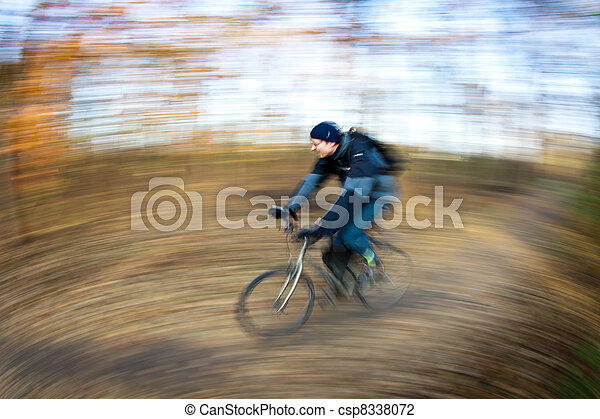 Bicycle riding in a city park on a lovely autumn/fall day - csp8338072