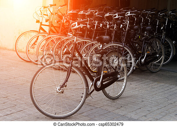 Bicycle rows parking at sunrise - csp65302479