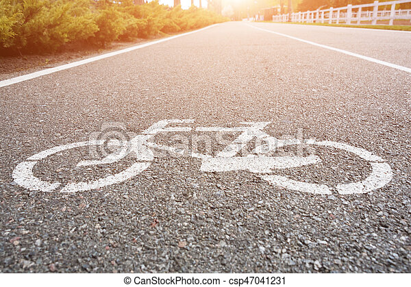 Bicycle sign on the road. Bike lane in the park - csp47041231