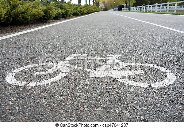 Bicycle sign on the road. Bike lane in the park - csp47041237