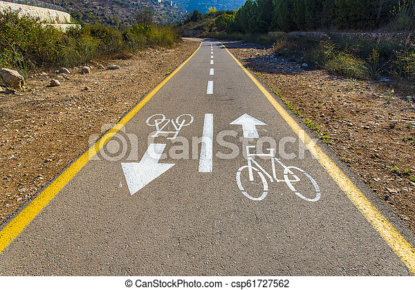 Bicycle sign on the road used for pedestrian crossing - csp61727562