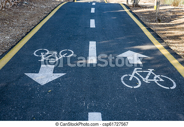 Bicycle sign on the road used for pedestrian crossing - csp61727567