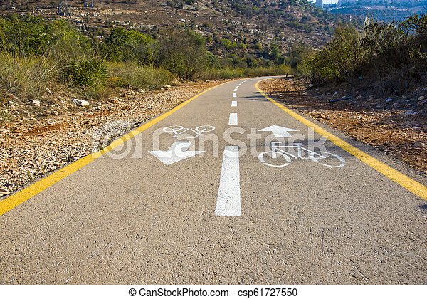 Bicycle sign on the road used for pedestrian crossing - csp61727550