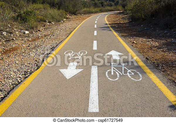 Bicycle sign on the road used for pedestrian crossing - csp61727549