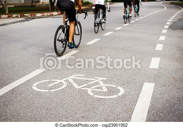Bicycle sign or icon and movement  of cyclist in the park - csp23901952