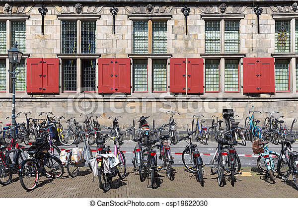 Bicycles in front of an old Dutch historic building - csp19622030