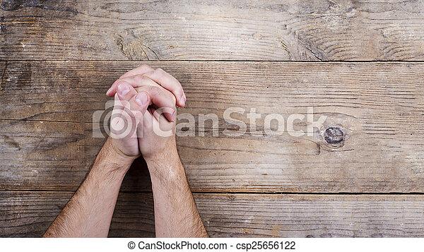 biddend, bijbel, handen - csp25656122
