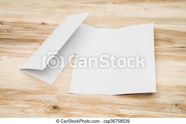 Bifold white template paper on wood texture - csp36758539