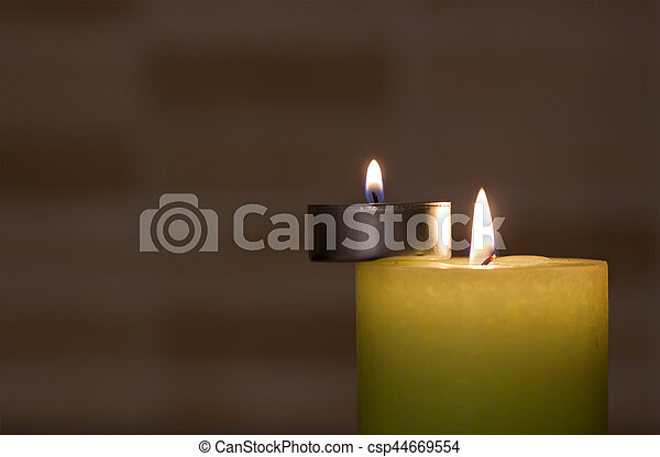 Big and little candles on dark background. - csp44669554