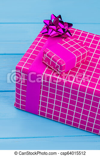 Big and little purple gift boxes. - csp64015512