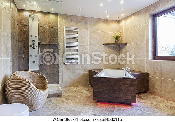Big bathtub in a bathroom - csp24530115