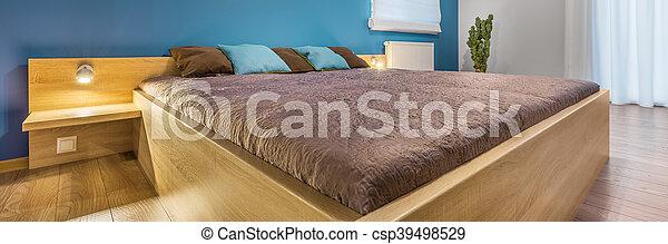 Big bed in simple bedroom - csp39498529