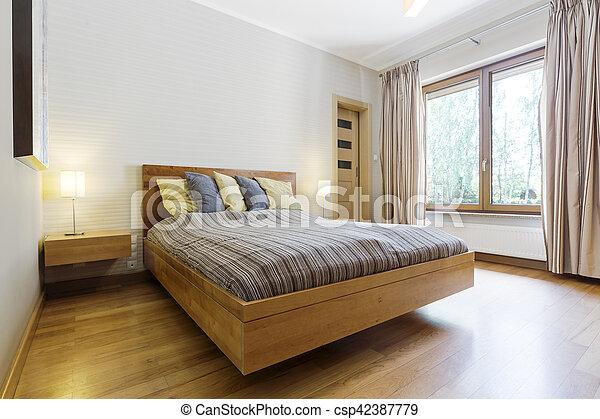 Big bed in the bedroom - csp42387779