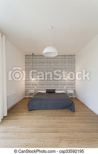 Big bed in the bedroom - csp33592195