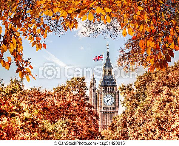 Big Ben clock against autumn leaves in London, England, UK - csp51420015