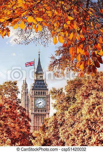 Big Ben clock against autumn leaves in London, England, UK - csp51420032