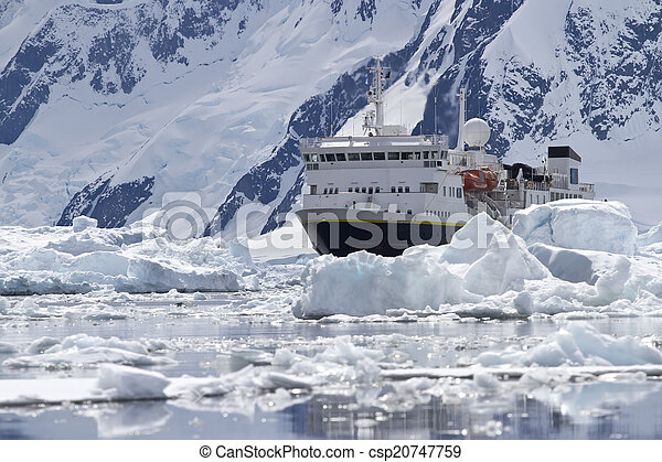 big blue tourist ship in the ice in the background of the Antarc - csp20747759