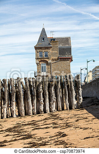 Big breakwater, 3000 trunks to defend the city from the tides in Saint-Malo, Ille-et-Vilaine, Brittany, France - csp70873974