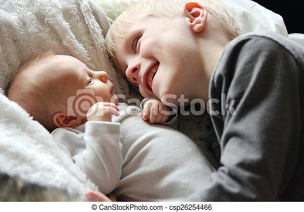 Big Brother Looking at Newborn Baby with Love - csp26254466