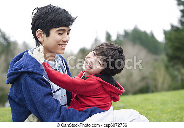 Big brother taking care of disabled little brother - csp6072756