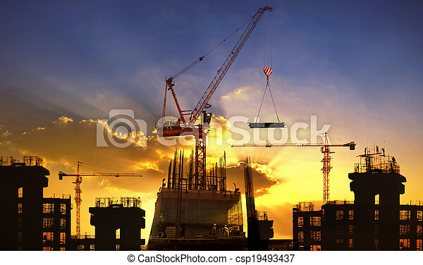 big crane and building construction against beautiful dusky sky use for construction industry and engineering - csp19493437
