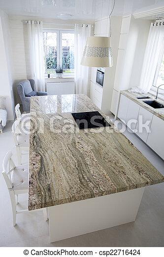 Big granitic worktop in bright kitchen - csp22716424