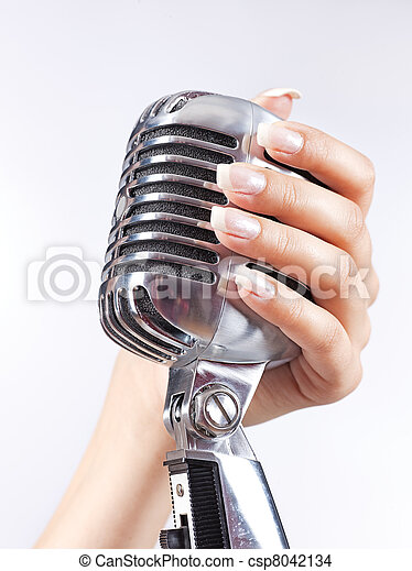 Big microphone in woman's hand - csp8042134