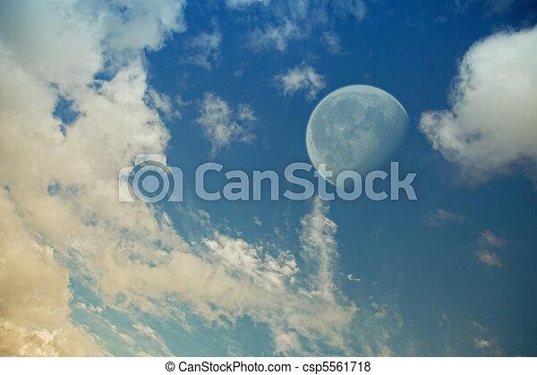 big moon in the evening sky - csp5561718