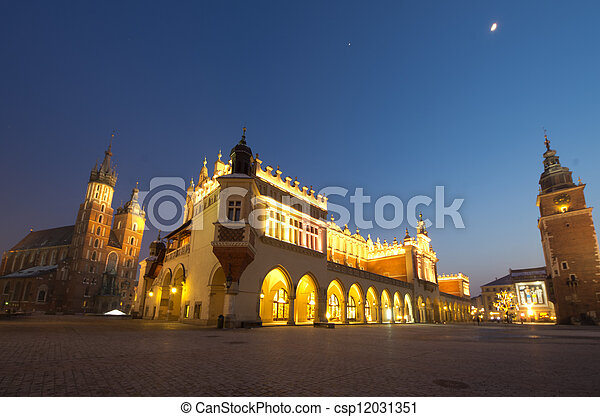 Big panorama of Rynek Main Market Square by Night, Krakow, Poland - csp12031351