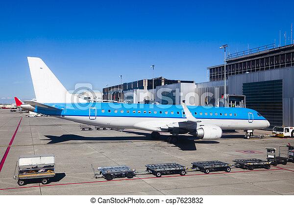 Big plane in an airport runway - csp7623832
