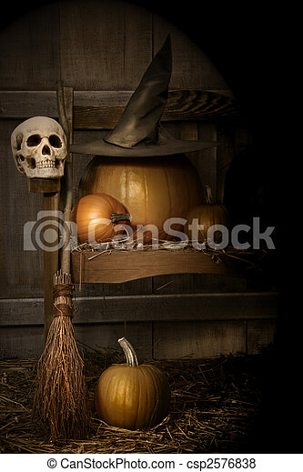 Big pumpkin with black witch hat and broom - csp2576838