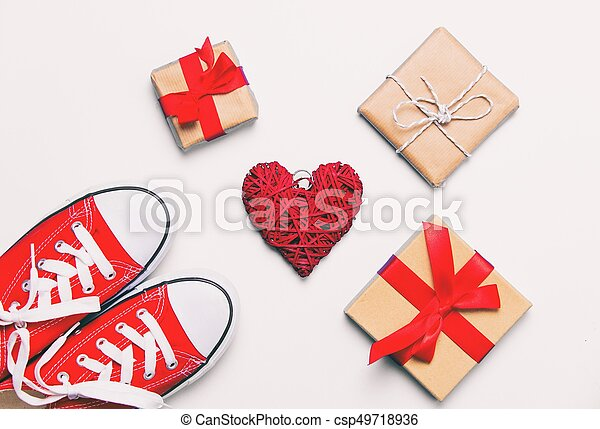 big red gumshoes, heart shaped toy and beautiful gifts - csp49718936