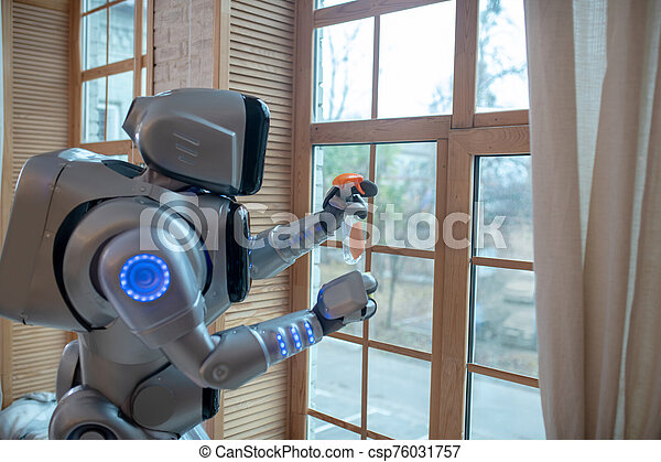 Big Robot Cleaning The Window In The Kitchen Doing Housework Big Robot Standing In The Kitchen Cleaning The Window Canstock