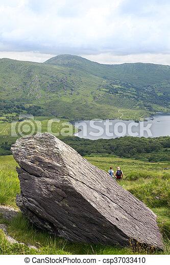 big rock with hikers - csp37033410