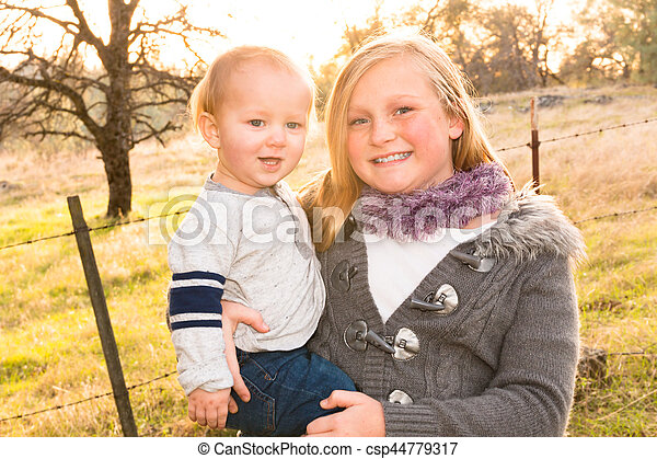 Big Sister With Little Brother - csp44779317
