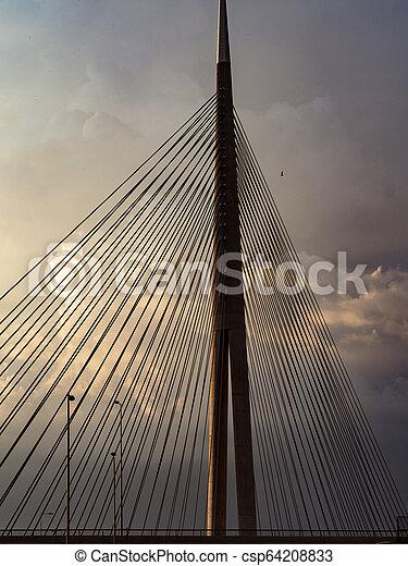 Big suspension bridge at sunset - csp64208833