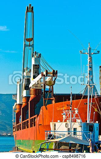 Big transportation boat at the bay against blue sky - csp8498716