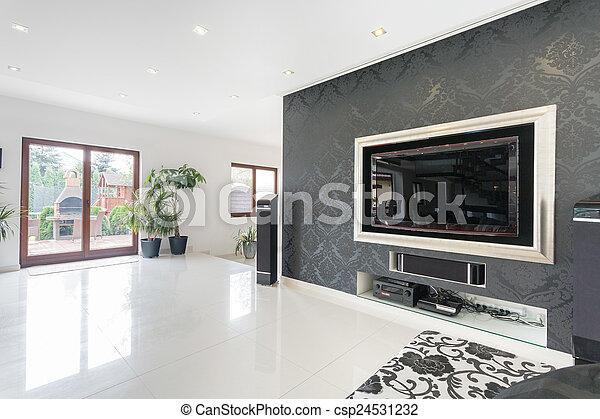 Big tv in a living room - csp24531232