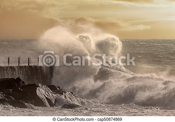 Big wave splash at sunset - csp50874869
