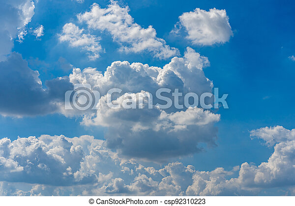 Big white clouds floating on summer blue sky - csp92310223