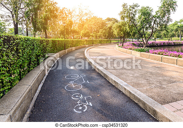 Bike lane with bicycle sign in urban park with sunlight. - csp34531320