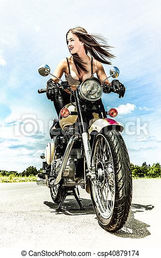 biker girl on a motorcycle - csp40879174