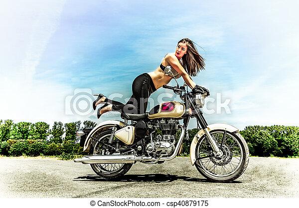 biker girl on a motorcycle - csp40879175
