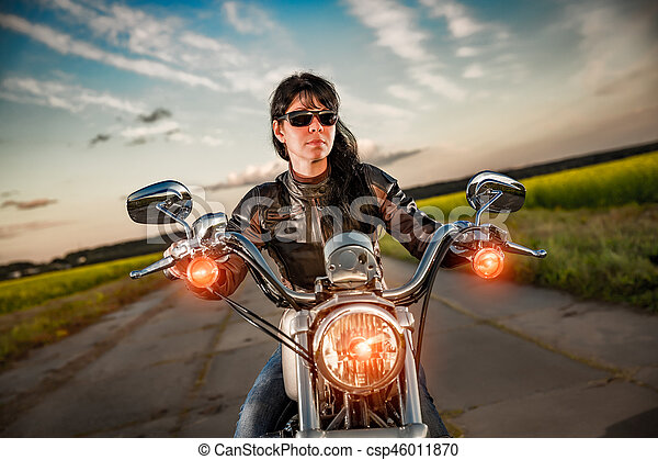 Biker girl on a motorcycle - csp46011870