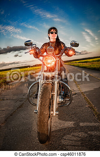Biker girl on a motorcycle - csp46011876