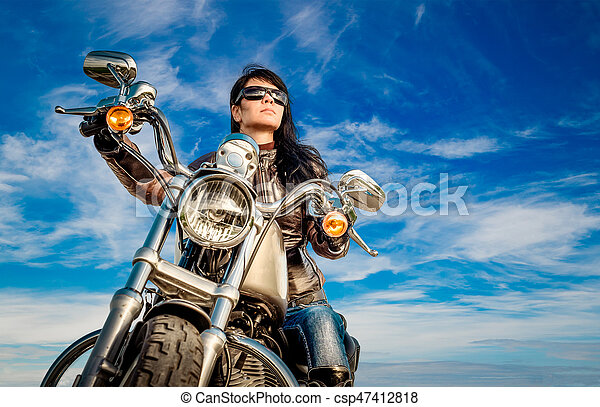 Biker girl on a motorcycle - csp47412818