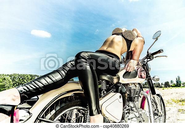 biker girl on a motorcycle - csp40880269